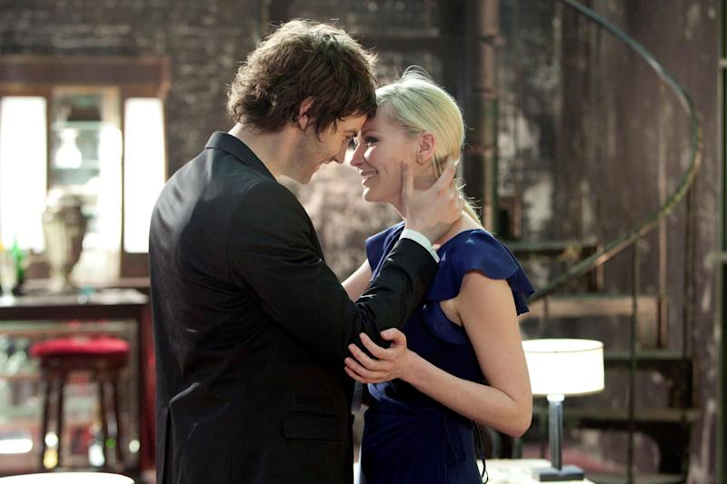 """This film image released by Millennium Entertainment shows Jim Sturgess, left, and Kirsten Dunst in a scene from """"Upside Down."""" (AP Photo/Millennium Entertainment)"""