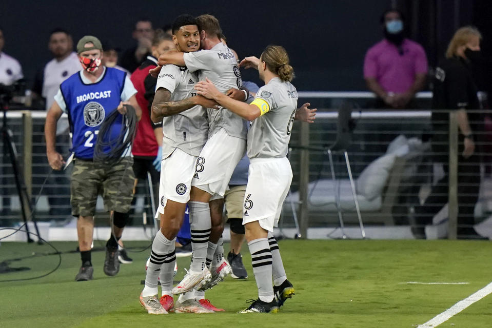 Montreal forward Bjorn Johnsen (9) celebrates with midfielder Djordje Mihailovic (8) and midfielder Samuel Piette (6) after scoring a goal during the first half of the team's MLS soccer match against Inter Miami, Wednesday, May 12, 2021, in Fort Lauderdale, Fla. (AP Photo/Lynne Sladky)