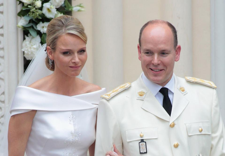 Princess Charlene and Prince Albert are seen leaving the Hotol de Paris to attend the religious ceremony