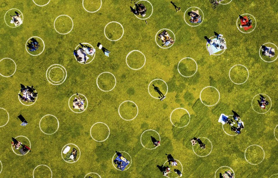 """<span class=""""caption"""">Circles designed to help prevent the spread of the coronavirus by encouraging social distancing line San Francisco's Dolores Park on May 21, 2020. </span> <span class=""""attribution""""><span class=""""source"""">(AP Photo/Noah Berger)</span></span>"""