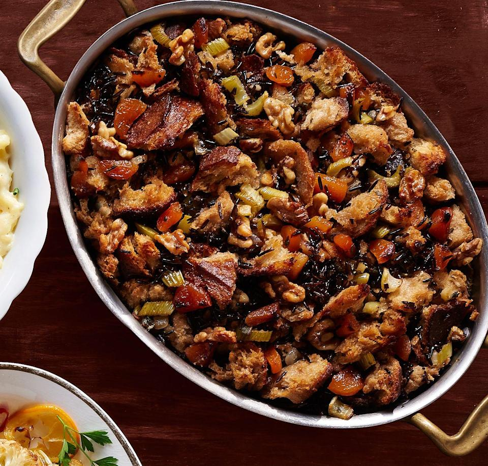 """<p>Wild rice and apricots give classic stuffing a sweet spin.</p><p>Get the recipe from <a href=""""https://www.delish.com/cooking/recipe-ideas/recipes/a45106/apricot-wild-rice-stuffing/"""" rel=""""nofollow noopener"""" target=""""_blank"""" data-ylk=""""slk:Delish"""" class=""""link rapid-noclick-resp"""">Delish</a>.</p>"""