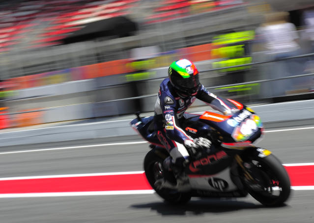 Pons 40 HP Tuenti's Spanish Pol Espargaro leaves the pits of the Catalunya racetrack in Montmelo, near Barcelona, on June 1, 2012, during the Moto2 second training session of the Catalunya Moto GP Grand Prix. AFP PHOTO / JOSEP LAGOJOSEP LAGO/AFP/GettyImages