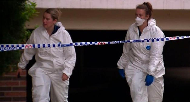 Two forensic workers are seen at the unit of Sabah Hafiz, who was allegedly bashed to death at her Wentworthville unit on Wednesday morning.