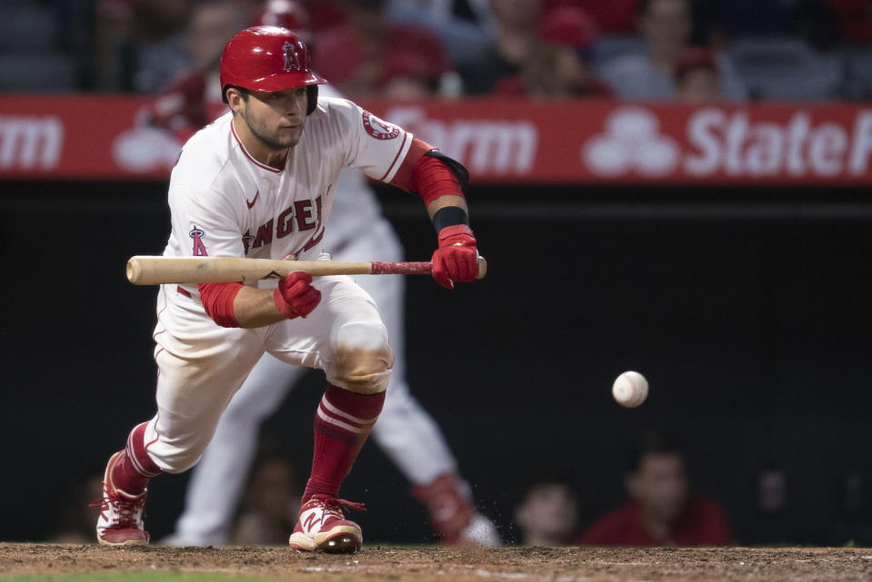 Los Angeles Angels' David Fletcher drops a sacrifice bunt during the sixth inning of the team's baseball game against the Detroit Tigers in Anaheim, Calif., Saturday, June 19, 2021. (AP Photo/Kyusung Gong)