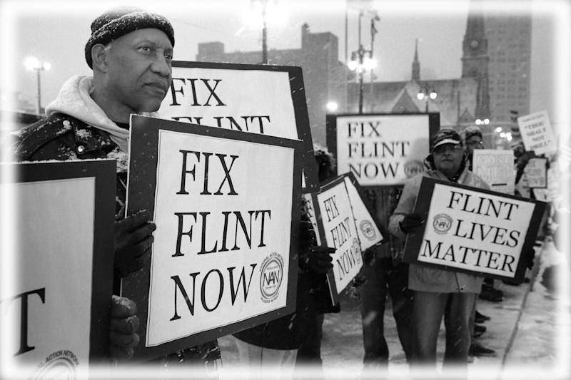 Demonstrators demand action from the Republican presidential candidates about the water crisis in Flint outside the historic Fox Theater before the GOP presidential debate in 2016 in Detroit, Michigan. (Photo: Chip Somodevilla/Getty Images; digitally enhanced by Yahoo News)