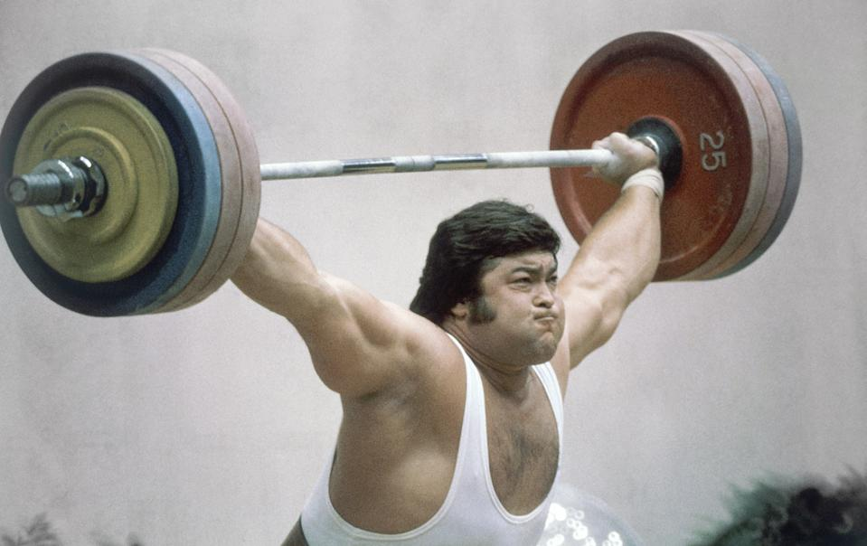 Soviet weightlifter Sultan Rakhmanov lifts a combined weight of 440 kilograms (968 pounds) to win gold medal in Olympic Super Heavyweight Division in the Weightlifting event at the Summer Olympic Games in Moscow, Russia on Wednesday, July 30, 1980. (AP Photo)