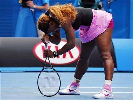 Serena Williams of the U.S. leans on her racquet during her women's singles match against Ana Ivanovic of Serbia at the Australian Open 2014 tennis tournament in Melbourne January 19, 2014. REUTERS/Petar Kujundzic