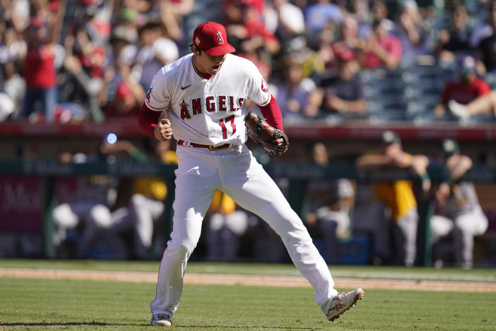 Los Angeles Angels starting pitcher Shohei Ohtani, of Japan, pumps his fist after striking out Oakland Athletics' Matt Chapman to end the eighth inning of a baseball game Sunday, Sept. 19, 2021, in Anaheim, Calif. (AP Photo/Jae C. Hong)