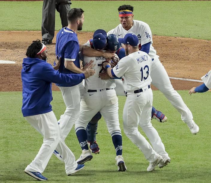 Dodgers players celebrate immediately after defeating the Tampa Bay Rays in Game 6 of the 2020 World Series.