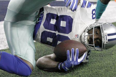 FILE PHOTO: Aug 19, 2016; Arlington, TX, USA; Dallas Cowboys wide receiver Dez Bryant (88) scores a touchdown in the first quarter against the Miami Dolphins at AT&T Stadium. Mandatory Credit: Tim Heitman-USA TODAY Sports / Reuters Picture Supplied by Action Images/File Photo
