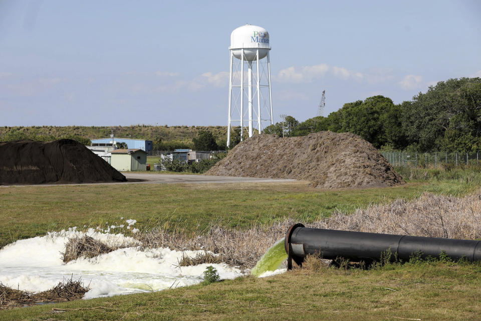Effluent flows from a pipe into a drainage ditch at Port Manatee South Gate on Tuesday, April 6, 2021, in Palmetto, Fla., where authorities responding to a leaking wastewater pond at the old Piney Point phosphate plant reopened a nearby stretch of U.S. 41 that had been closed for days between Manatee and Hillsborough counties. A mandatory evacuation order near the leaking Florida wastewater reservoir that affected more than 300 homes and additional businesses was lifted Tuesday as officials said the situation was under control.(Douglas R. Clifford/Tampa Bay Times via AP)