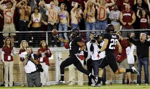 Stanford's Drew Terrell, center, runs down the sideline on a 76-yard punt return for a touchdown against Duke during the first half of an NCAA college football game in Stanford, Calif., Saturday, Sept. 8, 2012. (AP Photo/Marcio Jose Sanchez)