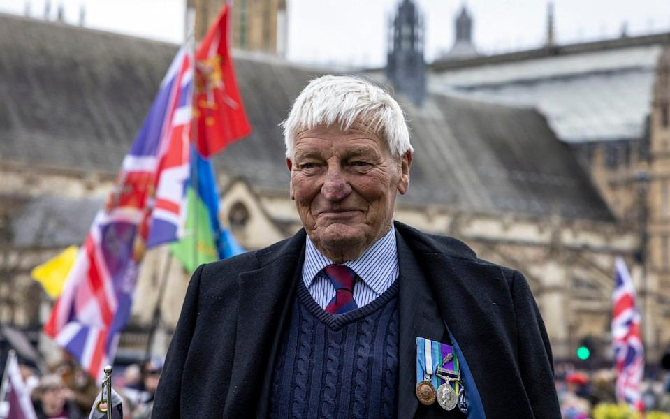 """Picture 258013681 08/05/2021 at 14:31 Owner : Commissioned Mcc0100039 . Sunday Telegraph DT News Northern Ireland veteran Dennis Hutchings who faces trial of Troubles killing spends 80th birthday protesting """"Witch Hunt"""" prosecutions outside parliament with Johnny Mercer . Hutchings was arrested in 1974 after the shooting of 27 yr old John Patrick Cunningham , he has always claimed his innocence . The decorated soldier, who is on dialysis, has twice been investigated and exonerated. But his trial is set to take place in the autumn. Westminster 8 May 2021 - Heathcliff O'Malley"""