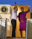 <p>To say goodbye to an epic family vacation filled with golfing, adventures, and shaved ice, President Obama and the First Lady offered up one last photo opp before departing for Washington, DC. The pair posed from Air Force One at the Joint Base Pearl Harbor-Hickam in Honolulu, matching in pink. While POTUS wore a blush button down, his wife was in a vibrant patterned dress with metallic detailing. <i>Photo: AP</i></p>