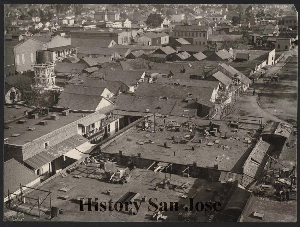 """This 1887 photo provided by History San Jose, part of the History San Jose Photographic Collection, shows a view of the roof tops of Market Street in Chinatown, before an arson fire in San Jose, Calif. More than a century after arsonists burned it to the ground in 1887, the San Jose City Council on Tuesday, Sept. 28, 2021, unanimously approved a resolution to apologize to Chinese immigrants and their descendants for the role the city played in """"systemic and institutional racism, xenophobia, and discrimination."""" (Andrew Putnam Hill/San Jose Research Library & Archives/History San Jose via AP)"""