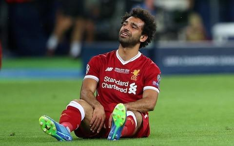 Liverpool's Mohamed Salah looks dejected after sustaining an injury - Credit: Reuters
