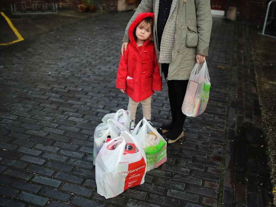 <p>There are 600,000 more children in poverty today than back in 2012</p> (Getty)