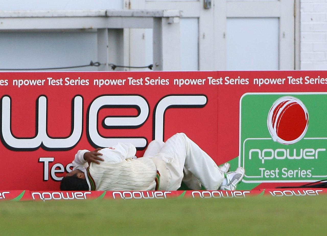 LEEDS, UNITED KINGDOM - MAY 25:  West Indies captain Ramnaresh Sarwan holds his shoulder after injuring it fielding a ball during day 1 of the second npower Test Match between England and the West Indies at Headingley on May 25, 2007 in Leeds, England.  (Photo by Tom Shaw/Getty Images)