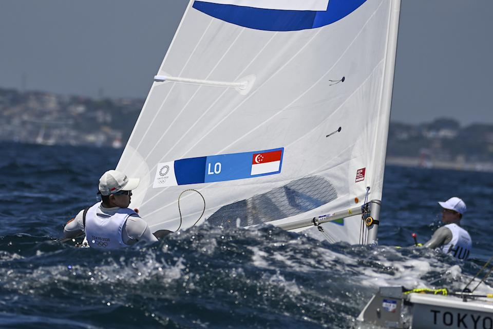Singapore sailor Ryan Lo competes in the men's laser event at the 2020 Tokyo Olympics. (PHOTO: Olivier Morin/AFP)