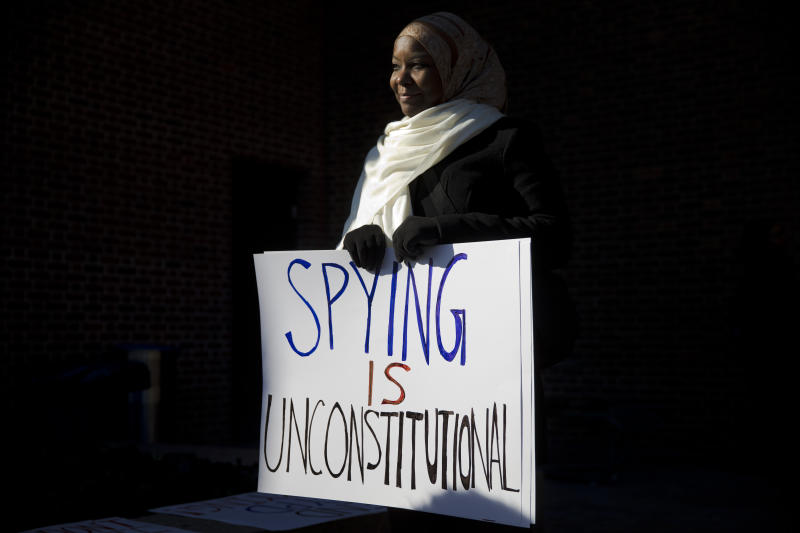 "FILE - In this Jan. 13, 2015 file photo, Kameelah Rashad, president of Muslim Wellness Foundation, demonstrates outside the U.S. Courthouse in Philadelphia. In the wake of George Floyd's death in police custody, dozens of American Muslim organizations have come together to call for reform to policing practices, and to support black-led organizations. ""I'm hopeful and heartened by the number and diversity of groups that have signed on,"" said Rashad. ""That says to me that there's at least recognition that we as a whole can no longer separate Islamophobia, anti-Black racism, surveillance, and violence."" (AP Photo/Matt Rourke, File)"