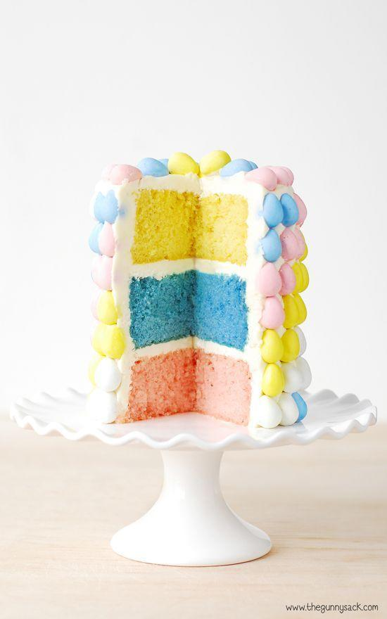 "<p>This pastel layer cake is easier to pull off than you'd think: Divide store-bought cake batter into three bowls, tint each one with dye, and bake.</p><p><em><a href=""http://www.thegunnysack.com/cadbury-mini-eggs-layer-cake/"" rel=""nofollow noopener"" target=""_blank"" data-ylk=""slk:Get the recipe from The Gunny Sack »"" class=""link rapid-noclick-resp"">Get the recipe from The Gunny Sack »</a></em> </p>"