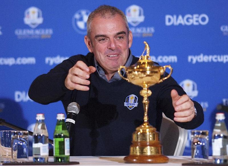 Paul McGinley of Ireland reaches for the trophy after being named as team Captain for the 2014 European Ryder Cup Team following a meeting of the Tournament Committee of the European Tour in Abu Dhabi, United Arab Emirates, Tuesday, Jan. 15, 2013. (AP Photp/Manuel Salazar)