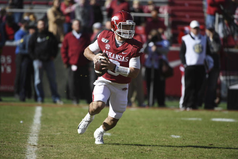 Arkansas quarterback John Stephen Jones scrambles out of the pocket against Western Kentucky during the second half of an NCAA college football game, Saturday, Nov. 9, 2019, in Fayetteville, Ark. (AP Photo/Michael Woods)