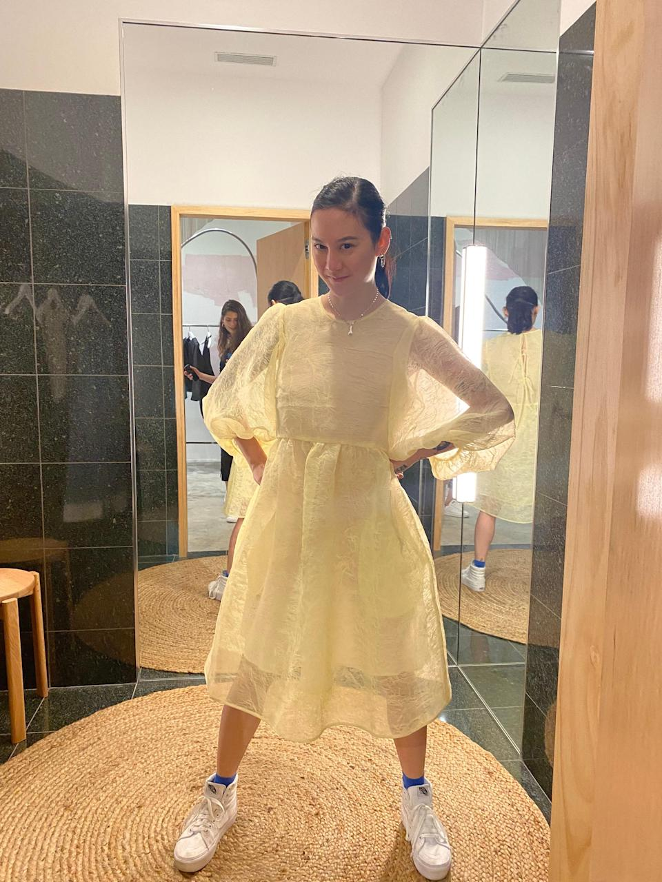 Zauner from Japanese Breakfast wears a Simone Rocha dress that reminds me of an amazing cake, an earring from Sandy Liang, a rice paddle necklace from Sisterfriend and a pair of Vans.