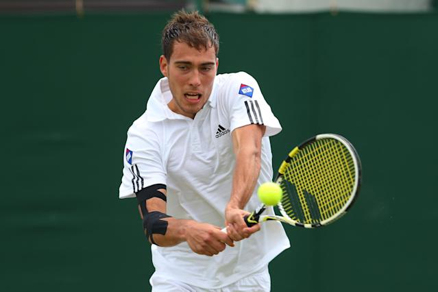 LONDON, ENGLAND - JULY 01: Jerzy Janowicz of Poland plays a backhand during the Gentlemen's Singles fourth round match against Jurgen Melzer of Germany on day seven of the Wimbledon Lawn Tennis Championships at the All England Lawn Tennis and Croquet Club on July 1, 2013 in London, England. (Photo by Julian Finney/Getty Images)