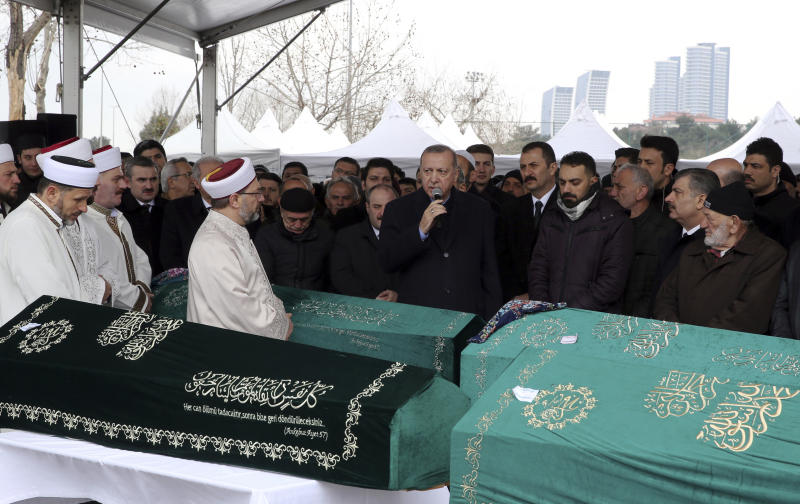 "Turkey's President Recep Tayyip Erdogan, center, speaks as he joins hundreds of mourners who attend the funeral prayers for nine members of Alemdar family killed in a collapsed apartment building, in Istanbul, Saturday, Feb. 9, 2019. Erdogan says there are ""many lessons to learn"" from the collapse of a residential building in Istanbul where at least 17 people have died.(Presidential Press Service via AP, Pool)"
