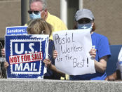 Postal supporters at the Main Southfield Post office worried about the crisis facing the U.S. Postal Service express their support on Tuesday, August 18, 2020 In Southfield, Mich. (Max Ortiz/The Detroit News via AP)