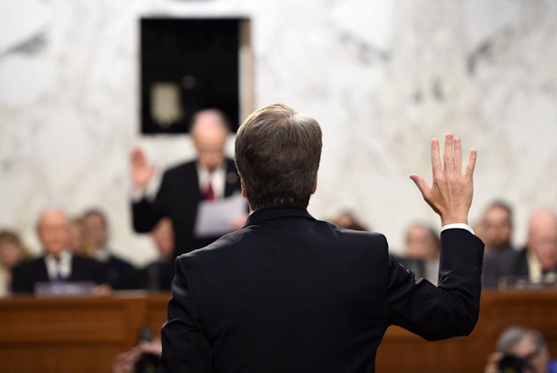 Kavanaugh is sworn in by the Chairman of the U.S. Senate Judiciary Committee Chuck Grassley, during his U.S. Senate Judiciary Committee confirmation hearing to be an associate justice on the U.S. Supreme Court on Sept. 4, 2018.<i></i> (Photo: BRENDAN SMIALOWSKI via Getty Images)
