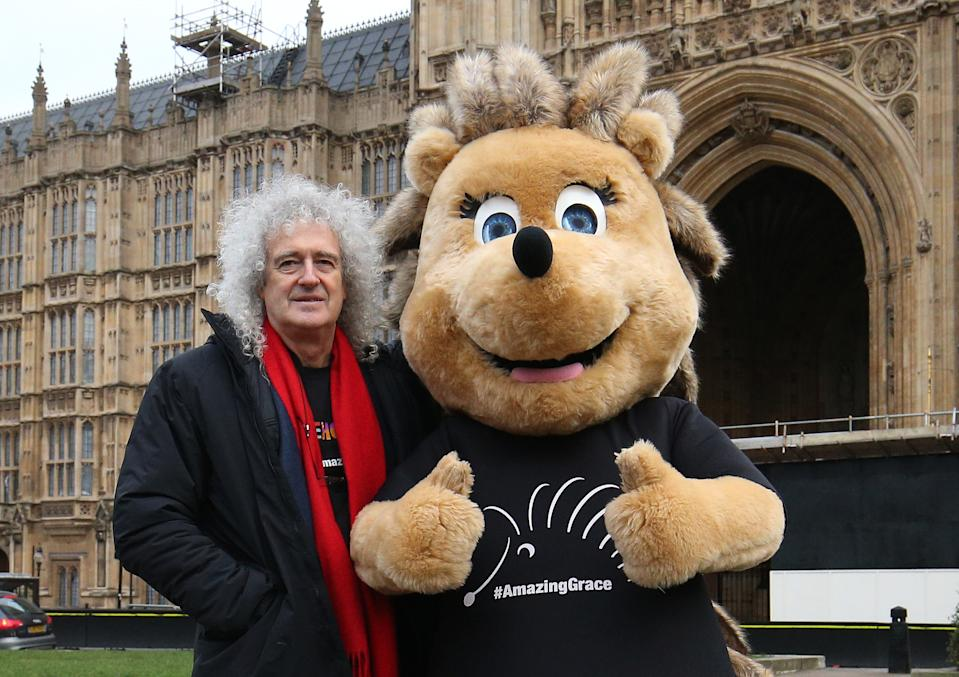 Brian May stands beside Grace the Hedgehog, mascot of the Save Me Trust, in College Green, opposite the Palace of Westminster in London. (Photo by Jonathan Brady/PA Images via Getty Images)