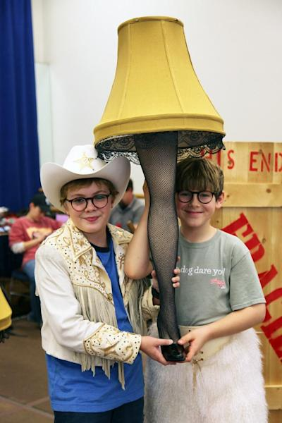 """In this Oct. 26, 2012, photo, Joe West, left, and Johnny Rabe hold a lace-stocking-clad leg lamp, one of the props from """"A Christmas Story, the Musical"""" in New York. Both 12-year-old boys are making their Broadway debuts playing Ralphie in the stage adaptation of the cult 1983 film. (AP Photo/Mark Kennedy)"""