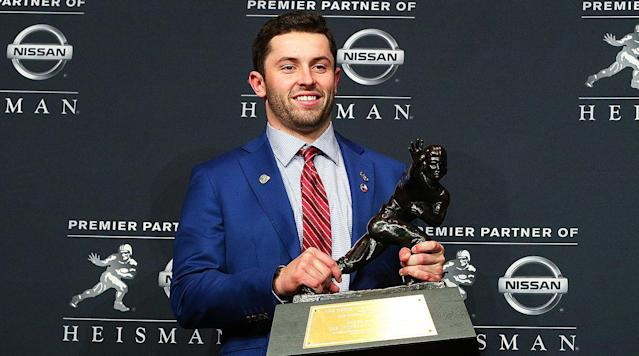 "<p>NEW YORK — About three hours before he'd be named this college football season's most outstanding player, Baker Mayfield acted like he didn't know what was coming. Dressed in a royal blue suit with a crimson tie and seated to the left of Stanford running back Bryce Love and Louisville quarterback Lamar Jackson—the two other finalists for the honor—during a news conference inside a spacious sixth-floor ballroom at the Marriott Marquis hotel here, Mayfield was asked about his anticipation heading into the Heisman Trophy ceremony on Saturday night. He responded with what sounded like a pre-recorded sequence of platitudes.</p><p>""I'm really happy to be here,"" Mayfield said. ""It's an honor to be here. It's an honor to be around these guys, be around past winners."" A few minutes later, at a question-and-answer session with reporters, Mayfield rejected an opportunity to acknowledge the obvious. ""You can't listen to it,"" he said when queried on the media coverage anointing him the overwhelming Heisman frontrunner, before pivoting to a comparison with his preferred team-wide approach to the weekly College Football Playoff rankings. ""You can't listen to the outside noise,"" Mayfield added.</p><p>The noise was deafening, though. Mayfield is the 83rd winner of the Heisman, and as much as he tried in the hours before the announcement to maintain the pretense that the outcome of the race was in doubt—including by revealing that he'd waited until Saturday to put together his acceptance speech—pretty much everyone knew he'd finish on top long before it became official. ""This is unbelievable for me,"" Mayfield said after taking the stage at the PlayStation Theater to greet past victors, reel off a list of shoutouts and clutch the bronze trophy.</p><p>This was one of the most anticlimactic Heisman chases in recent memory. Mayfield had been viewed as the favorite since early in the final month of the regular season, after he lit up Oklahoma State's defense in a 10-point win at Oklahoma State on Nov. 4. From there, Mayfield guided Oklahoma to four consecutive wins, a Big 12 championship and a berth in the playoff as the No. 2 seed. (The Sooners will take on No. 3 seed Georgia in the Sugar Bowl on New Year's Day.) His edge over the rest of the field was so convincing that by the time the voting closed, the biggest knock on Mayfield's candidacy was his sideline comportment during a blowout victory over a conference doormat.</p><p>The most notable aspect of Mayfield's run to claim college sports's most prestigious individual honor was his passing precision. Blend a gifted thrower at the top of his game, an uptempo scheme geared to make the most of his ability to rifle balls in tight windows, a head coach (Lincoln Riley) who'd spent the two previous years sharpening that thrower's skill set, a deep cast of skill-position playmakers and this is what you get: Mayfield completing a nation-high 71% of his passes, placing second in the country with 41 touchdown passes, breaking his own single-season record for passer rating (203.8) and setting a single-season high for passing yards per attempt (11.8).</p><p>Mayfield, who walked on at Texas Tech and played eight games for the Red Raiders as a freshman in 2013 before transferring to Oklahoma and walking on again, is the first walk-on to win the Heisman. He's also the first senior (fifth-year) since Ohio State quarterback Troy Brown in 2006. Mayfield garnered 732 first-place votes, the fifth-most ever, and he received the third-highest percent of total possible points, with 2,398 (86%). The four players who've drawn more first-place votes are USC's O.J. Simpson (855, 1968), Smith (801, 2006), Oregon's Marcus Mariota (788, 2014) and Florida State's Charlie Ward (740, 1993), and the two players who've registered higher points percentages are Smith (91.63%) and Mariota (90.92%).</p><p>The second-place finisher this season, Stanford's Love, amassed 75 first-place votes and 1,300 points, while the third-place finisher, Louisville's Jackson, totaled 47 first-place votes and 793 points. Love's runner-up placement must have evoked a familiar feeling in Cardinal fans. Stanford now has produced six second-place finishes in the Heisman voting, more than any other program.</p><p>Like Stanford, Oklahoma had five runners-up before Saturday. Unlike Stanford, it also had five winners. Mayfield joins these Sooners: quarterback Sam Bradford (2008), quarterback Jason White (2003), running back Billy Sims (1978), running back Steve Owens (1969) and running back Billy Vessels (1952). Mayfield's victory also jibes with the Heisman's recent positional history: He's the second straight quarterback to take home the award, and the 15th signal-caller since 2000. (The only two non-QBs this century were Alabama running backs, Derrick Henry in 2015 and Mark Ingram in 2009.)</p><p>This is not a career achievement award for Mayfield, although there is some surface-level evidence to back up that notion. As pointed out by Heisman historian Chris Huston in an interview, Mayfield is one of only seven players to finish in the top five of the voting three times, climbing from fourth in 2015 to third in 2016 to first in 2017. He began his college career before the advent of the playoff, and he's since led Oklahoma to it twice, in non-successive years. There's a persistence to Mayfield's star power that's uncommon at a time in which the number of NFL draft early entrants has spiked.</p><p>The eighth-year-senior vibe Mayfield gives off does not owe exclusively to his ability to throw a football with remarkable accuracy over the course of several seasons. He's become college football's main magnet for controversy. There was the offseason arrest over an incident in Fayetteville, Ark., in which released footage showed police tackling a drunken Mayfield into a wall, the midfield flag <a href=""https://www.si.com/college-football/2017/09/09/baker-mayfield-oklahoma-flag-ohio-state-win"" rel=""nofollow noopener"" target=""_blank"" data-ylk=""slk:wave-and-spear into the Ohio State logo"" class=""link rapid-noclick-resp"">wave-and-spear into the Ohio State logo</a> after a 31–16 win over the Buckeyes in September, the Big 12 walk-on transfer eligibility rule reversal and, of course, <a href=""https://www.si.com/college-football/2017/11/18/baker-mayfield-curses-grabs-crotch-oklahoma-kansas-video"" rel=""nofollow noopener"" target=""_blank"" data-ylk=""slk:the triple F--- you! and crotch grab"" class=""link rapid-noclick-resp"">the triple F--- you! and crotch grab</a> during a game at Kansas last month.</p><p>• <strong><a href=""https://www.si.com/college-football/photo/2017/12/07/all-america-teams-baker-mayfield-bryce-love"" rel=""nofollow noopener"" target=""_blank"" data-ylk=""slk:Baker Mayfield leads SI's 2017 All-America Teams"" class=""link rapid-noclick-resp"">Baker Mayfield leads SI's 2017 All-America Teams</a></strong></p><p>None of it obscured a peerless on-field track record that includes 14,320 passing yards, 129 passing touchdowns, three All-Big 12 First Team nominations, two conference offensive player of the year awards and culminated with a resplendent 2017 season. Mayfield's challenge as a Heisman contender entering this fall was straightforward but immense. With his top receiver, Dede Westbrook, off to the NFL, Mayfield needed to be better than the player who shattered the record for passing efficiency and checked in behind only Louisville's Jackson and Clemson's Deshaun Watson on the ballot a year ago.</p><p>That said, the Heisman electorate's familiarity with Mayfield probably helped him more than it hurt him in the end. ""There's a large body of evidence for certain players who have had good seasons over the course of their career,"" Huston says of voters. ""And so, whereas the player who comes out of nowhere and has a big year—there might be a little bit of thinking that, 'Is this a one-time thing? Is this a fluke?' Having those multiple years definitely establishes the person as a quality player. And so, they don't really have to deal with that apprehension if someone comes out of nowhere.""</p><p>The first big sign that Mayfield would end up back in New York in 2017 came during Oklahoma's 15-point victory over Ohio State in September. A year after being whipped, 45–24, in Norman by the Buckeyes, the Sooners went into the Horseshoe and notched one of the best nonconference Ws of the season. Mayfield buried the Buckeyes with 386 yards and three touchdowns with zero interceptions on 27-of-25 passing while upstaging then-Heisman candidate J.T. Barrett, who finished 19-of-35 with 183 yards and a pick. Oklahoma may not have needed the Ohio State win to make the playoff, but at the time it resonated as a towering triumph.</p><p>The reputationally defense-averse Big 12 didn't have many more answers for Mayfield than Ohio State did. Against conference competition, he topped all Big 12 quarterbacks by connecting on 69.3% of his throws; his yards per attempt mark, 11.5, was more than two YPA higher than the Big 12 quarterback who placed second in that category (Oklahoma State's Mason Rudolph); he tossed a league-high 31 touchdowns against only five interceptions despite ranking sixth among Big 12 signal-callers in attempts per game; and he powered the Sooners to a league-high 44.1 points per contest.</p><p>Not even TCU, the Big 12's only top-15 Football Bowl Subdivision defense, according to Football Outsiders S&P+ ratings, stood much of a chance trying to bottle up Mayfield. Three weeks after carving up the Horned Frogs' D' to the tune of 333 passing yards and three touchdowns at Memorial Stadium on Nov. 11, he tore it asunder on a neutral field, hitting on 15 of his 23 throws for 243 yards with four touchdowns and zero interceptions in a 41–17 Big 12 championship game victory at AT&T Stadium to seal Oklahoma's second berth into the final four in three years.</p><p>Mayfield didn't deliver quite as many signature moments as many recent winners, but one tilt seemed to turn the race in his favor. In a Bedlam matchup billed as the Big 12's game of the year, Mayfield unloaded on in-state rival Oklahoma State in a scoreboard-shaking thrill ride, passing for a school-record 598 yards and five touchdowns and rushing for one score to push Oklahoma past the Cowboys, 62–52, in Stillwater. Mayfield probably didn't recognize it in the moment, but during that game he offered a <a href=""https://twitter.com/OU_Football/status/927331903732150277"" rel=""nofollow noopener"" target=""_blank"" data-ylk=""slk:photo-worthy"" class=""link rapid-noclick-resp"">photo-worthy</a> Heisman pose while clutching the ball with his right arm and extending his left for a stiff arm.</p><p>The only significant on-field blemish on Mayfield's Heisman CV was a seven-point home loss to Iowa State in early October that had faded into the rearview once it came time for voters to submit their ballots. The defeat aged well, too, with the Cyclones rounding into a more formidable outfit than they seemed at the time. The Kansas-game outburst undoubtedly rubbed a lot of media members the wrong way, but realistically, given the lead Mayfield had already opened up by that point, it was never going to cost him enough votes to jeopardize his position at the front of the pack.</p><p>When Mayfield surged toward the end of the season, no one from the rest of the Heisman field mounted a serious challenge. USC's Sam Darnold fizzed out early. Penn State's Saquon Barkley put on his superman cape in a win at Iowa in late September, only to be leapfrogged later on by other backs. Love didn't receive the attention he likely would have with fewer late-night kick offs. Arizona's Khalil Tate couldn't sustain his torrid October pace. Jackson's repeat bid fell way short. Auburn's Kerryon Johnson was low on preseason hype and couldn't make up for it with a second-half push.</p><p>That is an incomplete list of candidacies that just didn't have enough juice to create any uncertainty in the lead-up to the unveil on Saturday, but Mayfield did sound relieved to put the formality behind him. ""It's a dream right now,"" Mayfield said. ""And I'm just trying to enjoy it."" This was a predictable coronation of a player who'd clearly separated himself from every other contender, who'd not only distinguished himself as this season's premier performer but one of the greatest ever at his position, regardless of how his college career ends. The absence of serious competitors for the award should not diminish what Mayfield did to earn it. Mayfield did not back into a Heisman win. He was so good that no one else managed to keep up.</p>"