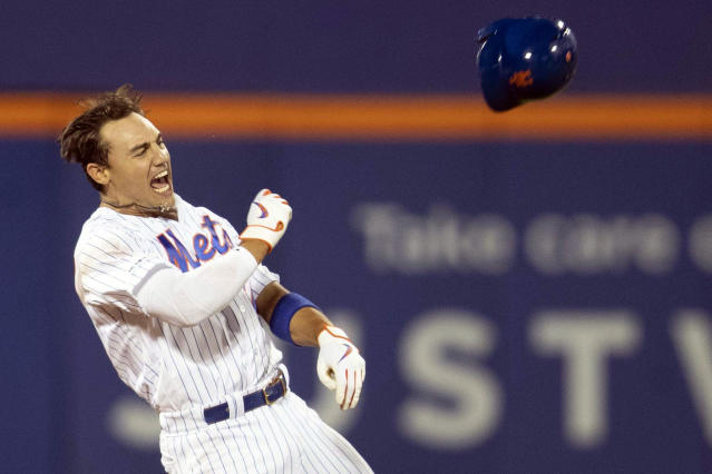 New York Mets' Michael Conforto reacts after hitting a walkoff single during the ninth inning to win the baseball game against the Washington Nationals, Friday, Aug. 9, 2019, in New York. (AP Photo/Mary Altaffer)