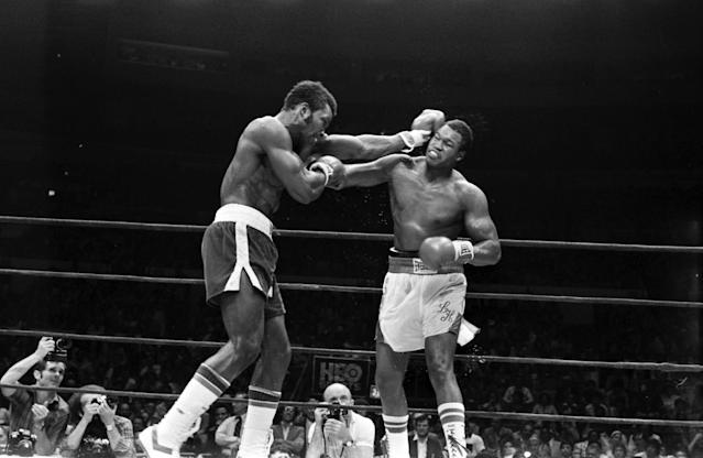 Larry Holmes, right, trades with Mike Weaver in New York in a fight that helped HBO solidify its boxing rep. (Getty)