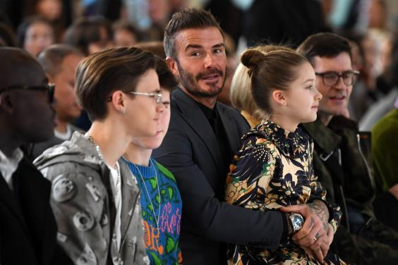 Beckham family sat front row at Victoria's LFW show (Getty)