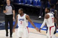 Los Angeles Clippers' Kawhi Leonard (2) and Paul George (13) celebrate a basket in the closing seconds of Game 3 of an NBA basketball first-round playoff series against the Dallas Mavericks in Dallas, Friday, May 28, 2021. (AP Photo/Tony Gutierrez)