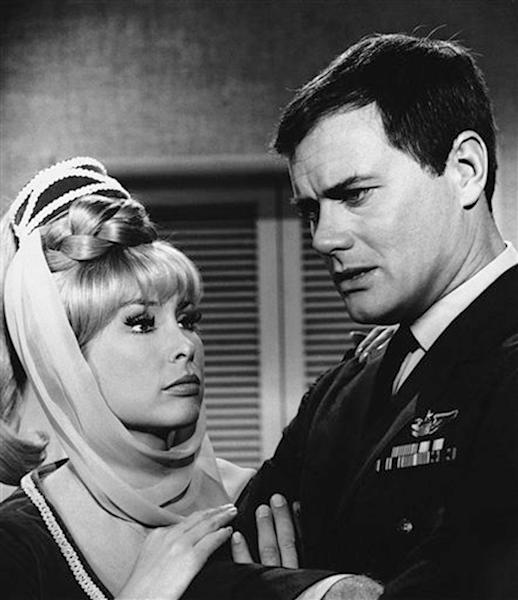 """FILE - This 1967 file photo shows Barbara Eden, left, and Larry Hagman in a scene from the television show """"I Dream of Jeannie."""" Actor Larry Hagman, who for more than a decade played villainous patriarch JR Ewing in the TV soap Dallas, has died at the age of 81, his family said Saturday Nov. 24, 2012. (AP Photo/NBC, file)"""