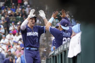 Chicago Cubs' Frank Schwindel (18) celebrates outside the dugout with Robinson Chirinos after hitting a home run in the sixth inning of a baseball game against the Pittsburgh Pirates, Friday, Sept. 3, 2021, in Chicago. (AP Photo/Charles Rex Arbogast)