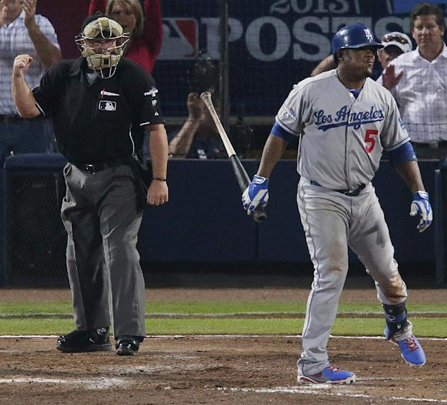 Los Angeles Dodgers' Juan Uribe (5) steps off home plate after striking out against Atlanta Braves starting pitcher Mike Minor in the sixth inning of Game 2 of the National League divisional series on Friday, Oct. 4, 2013, in Atlanta. (AP Photo/Dave Martin)