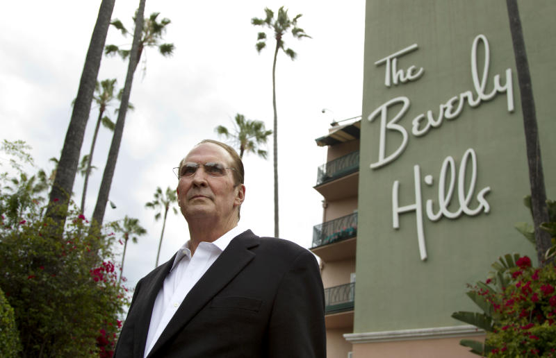 """In this April 25, 2012 photo, Robert S. Anderson, author and Beverly Hills Hotel historian, poses for a portrait in front of the Beverly Hills Hotel in Beverly Hills, Calif.  Anderson's book """"The Beverly Hills Hotel - The First 100 Years"""" celebrates the 100th anniversary of the Beverly Hills Hotel. (AP Photo/Matt Sayles)"""