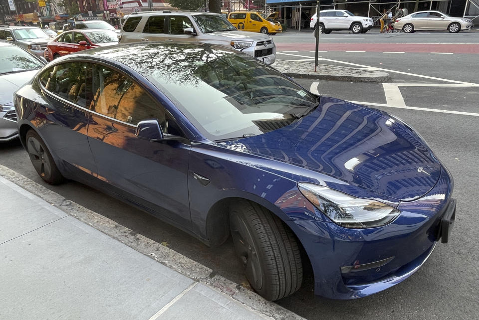 Photo by: STRF/STAR MAX/IPx 2021 7/26/21 Tesla profit surge driven by record car deliveries. STAR MAX Photo: 7/26/21 A Blue Tesla is seen in Manhattan.
