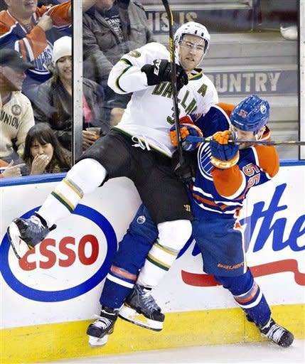 Dallas Stars' Stephane Robidas (3) is checked by Edmonton Oilers' Ben Eager (55) during second period NHL hockey action in Edmonton, Alberta, on Tuesday Feb. 12, 2013. (AP Photo/The Canadian Press, Jason Franson)