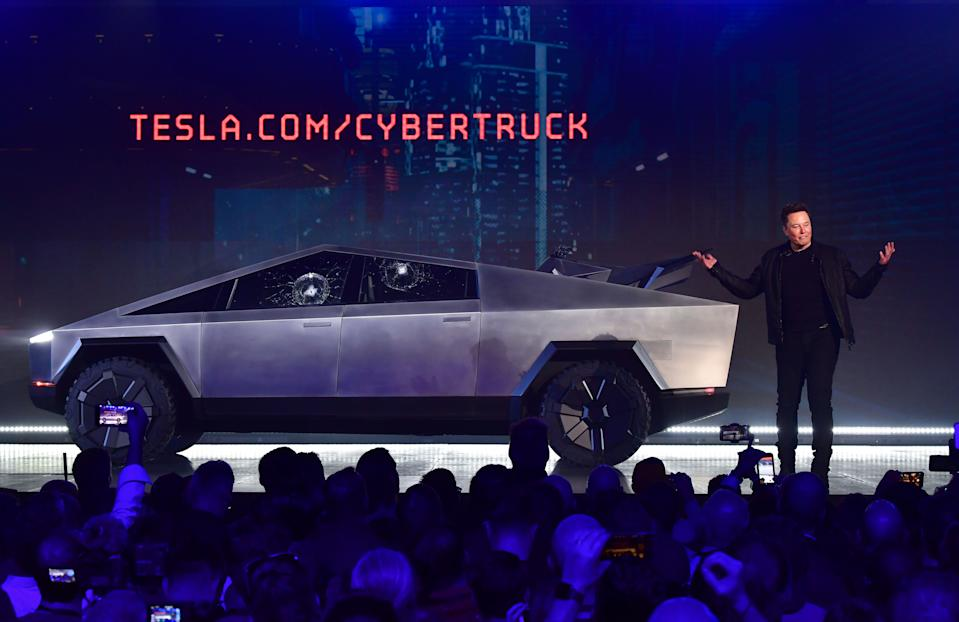 Tesla co-founder and CEO Elon Musk speaks in front of the newly unveiled all-electric battery-powered Tesla's Cybertruck with shattered windows, after a failed resistance test, at Tesla Design Center in Hawthorne, California on November 21, 2019. (Photo by FREDERIC J. BROWN / AFP) (Photo by FREDERIC J. BROWN/AFP via Getty Images)