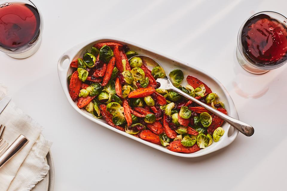 """This roasted-and-raw mix of vegetables gets tossed in a bright poppy seed dressing that lends a pleasing variety of textures to the holiday side dish. <a href=""""https://www.epicurious.com/recipes/food/views/roasted-carrot-brussels-sprout-and-cranberry-salad?mbid=synd_yahoo_rss"""" rel=""""nofollow noopener"""" target=""""_blank"""" data-ylk=""""slk:See recipe."""" class=""""link rapid-noclick-resp"""">See recipe.</a>"""