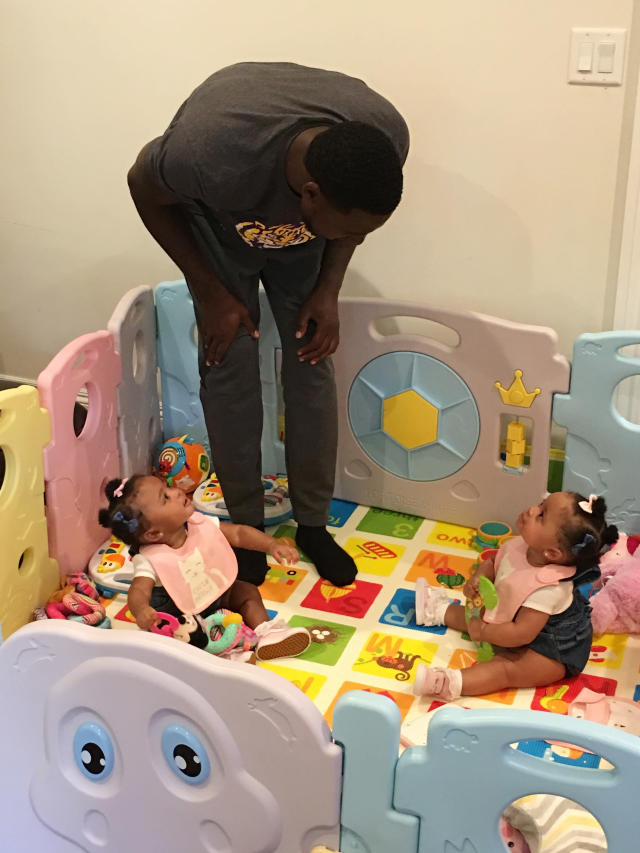 In this Thursday, June 14, 2018, photo, New York Jets cornerback Morris Claiborne plays with twin daughters MaKaila, left, and MaLiah at their home in Whippany, N.J. Last summer, Claiborne was trying to settle in with his new team, but his mind was on his newborn twins, one of whom was born underweight. (AP Photo/Dennis Waszak Jr.)