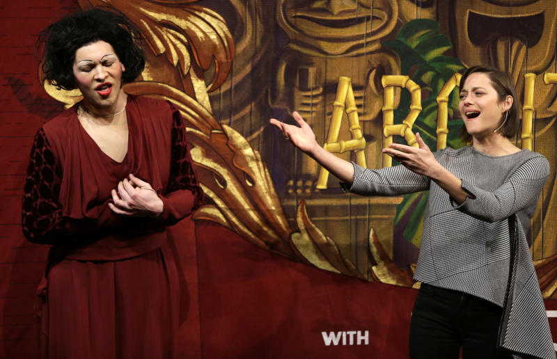 Actress Marion Cotillard, of France, right, sings Je Ne Regrette Rien, as Harvard University theatrical student Ethan Hardy, left, plays the role of Edith Piaf, in a spoof during Hasty Pudding Theatricals award ceremonies, at Harvard University, in Cambridge, Mass., Thursday, Jan. 31, 2013. Cotillard was awarded Hasty Pudding Theatricals woman of the year by the student theatricals society at Harvard. Cotillard played the staring role in a film about Piaf. (AP Photo/Steven Senne)