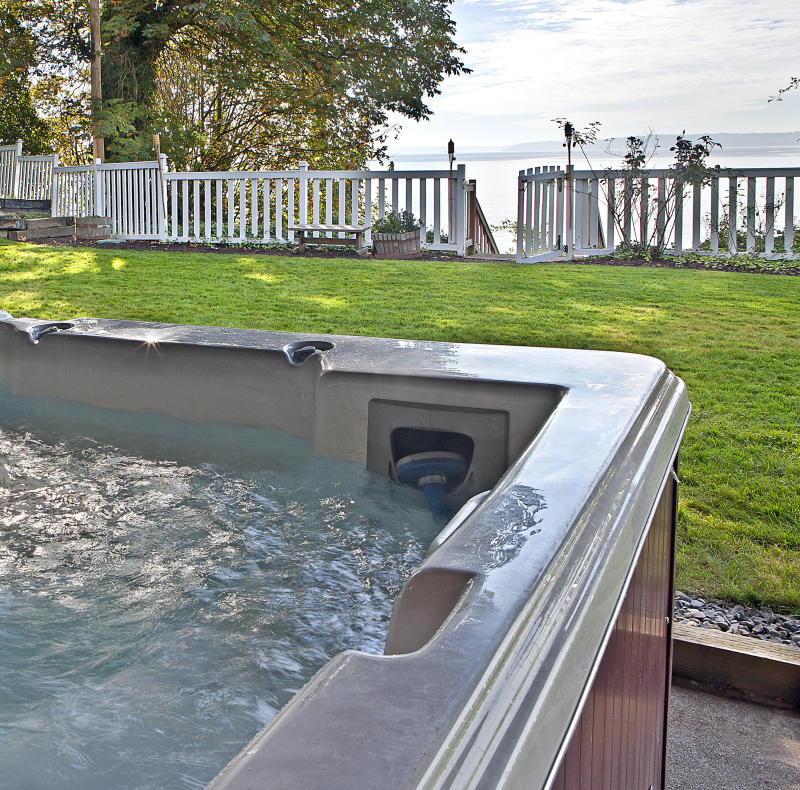Close up of hot tub in backyard. Photo: Getty